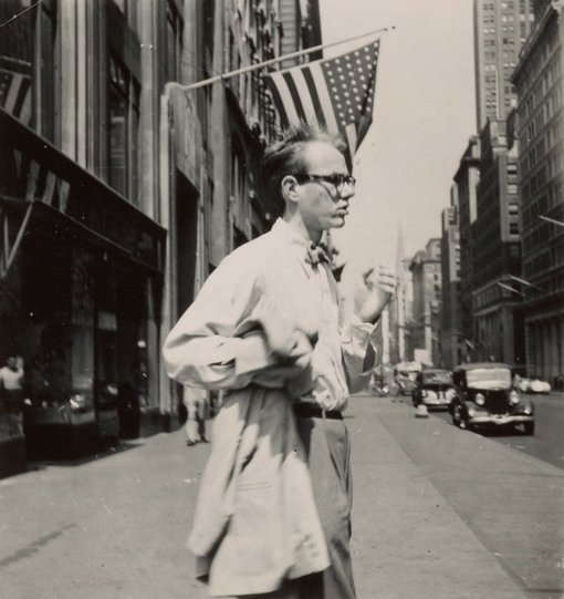 Photo of Andy Warhol on a city street.
