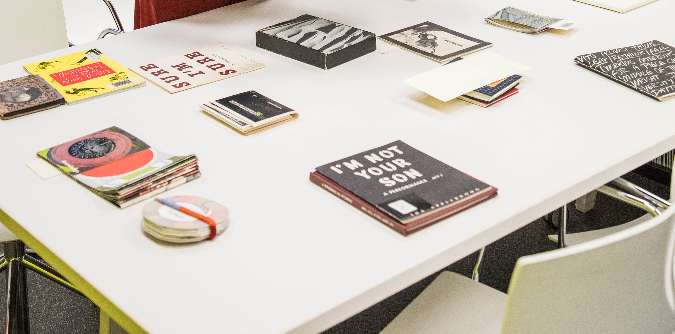 Artists' books on a table in the archives.